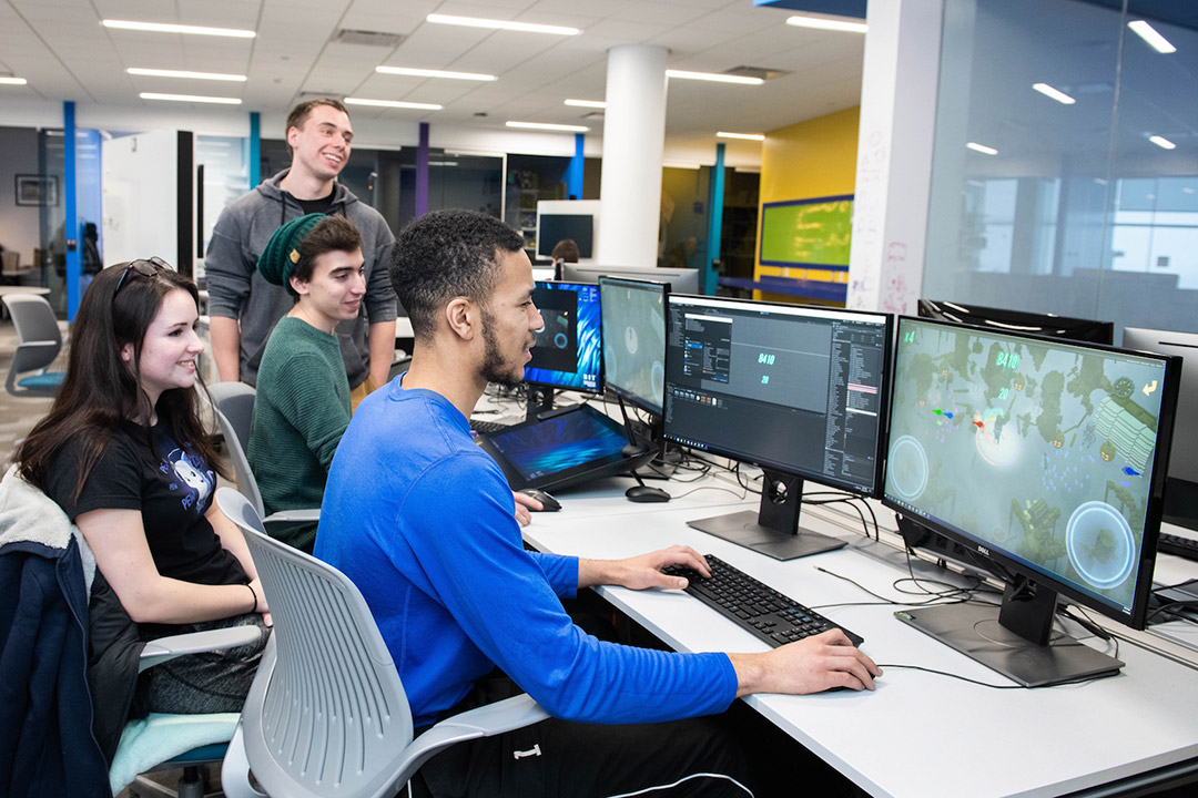 boy developing a game on PC